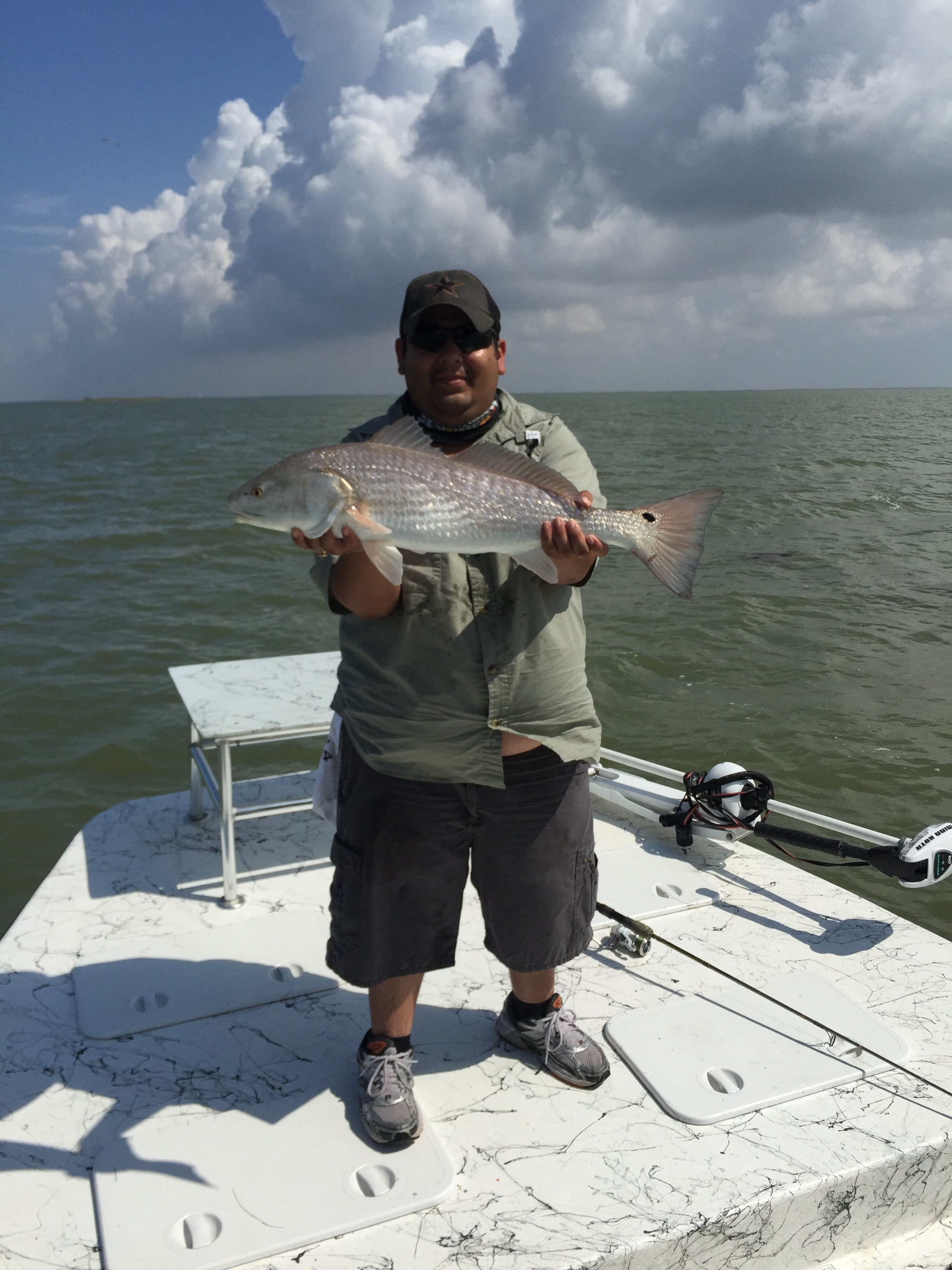 Jorge with 27in redfish Port Mansfield fishing guide